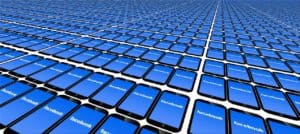 line of cell phone screens all showing the Facebook logo