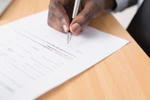 man signing an adoption contract